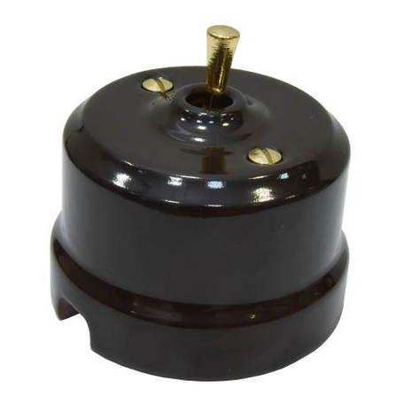 Выключатель 1-кл (проходной) тумблерный Lindas 34512-G, цвет коричневый/латунь