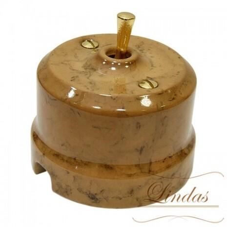 Выключатель 1-кл (проходной) тумблерный Lindas 34530-G, цвет капучино/латунь