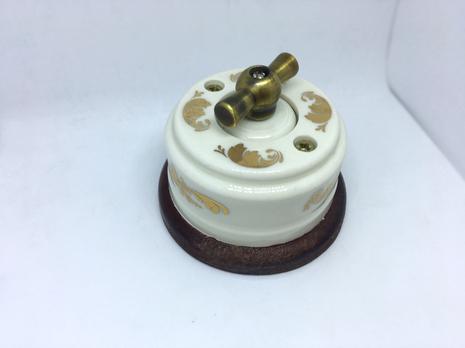 Выключатель 1-кл (проходной) 1 поз. (Золото) с подроз. вишня с МЕТАЛ. РУЧКОЙ бронза арт.Z003170