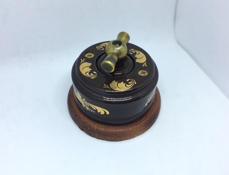 Выключатель 1-кл (проходной) 2х позиц. (Магия золота) с подроз. вишня с МЕТАЛ. РУЧКОЙ бронза арт.Z003216